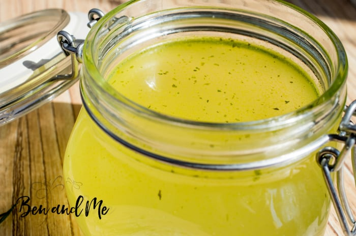 Canned broth, bouillon, clear soup in a glass jar